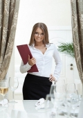 Image of attractive hostess smiling in restaurant
